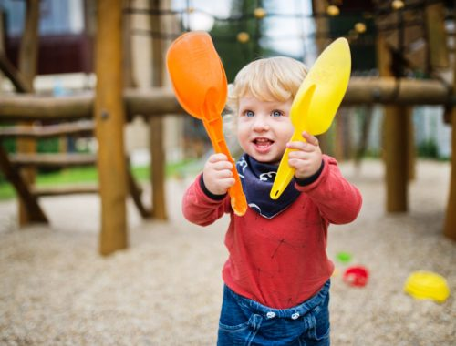toddler-boy-playing-in-the-playground-summer-day-PB8C7FR.jpg